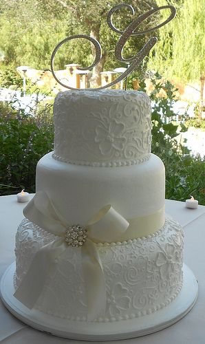 White elegant wedding cake - probably wouldn't put a big bow on