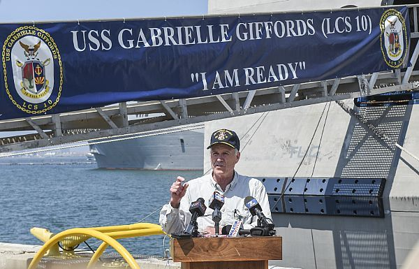 Secretary of the Navy Richard V. Spencer delivers remarks during a press conference on the pier alongside the littoral combat ship USS Gabrielle Giffords (LCS 10).