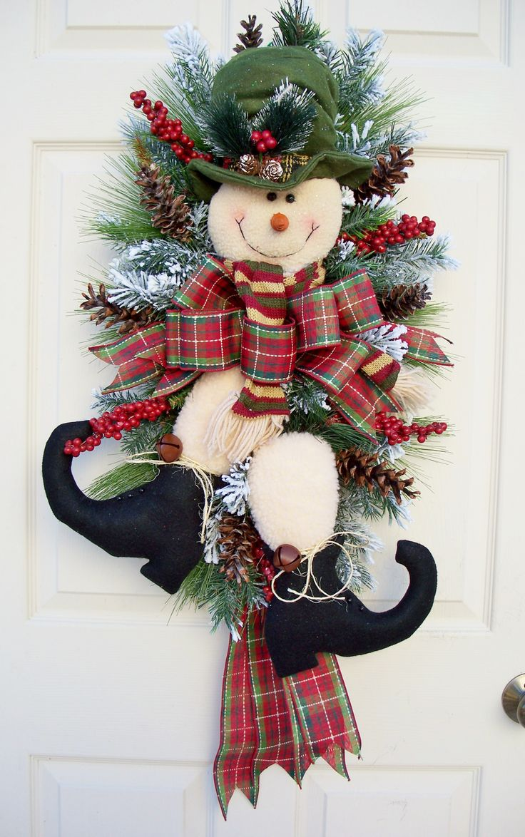 Mr. Snowman Swag for winter decoration. http://www.timelessfloralcreations.com/ https://www.facebook.com/timelesswreaths