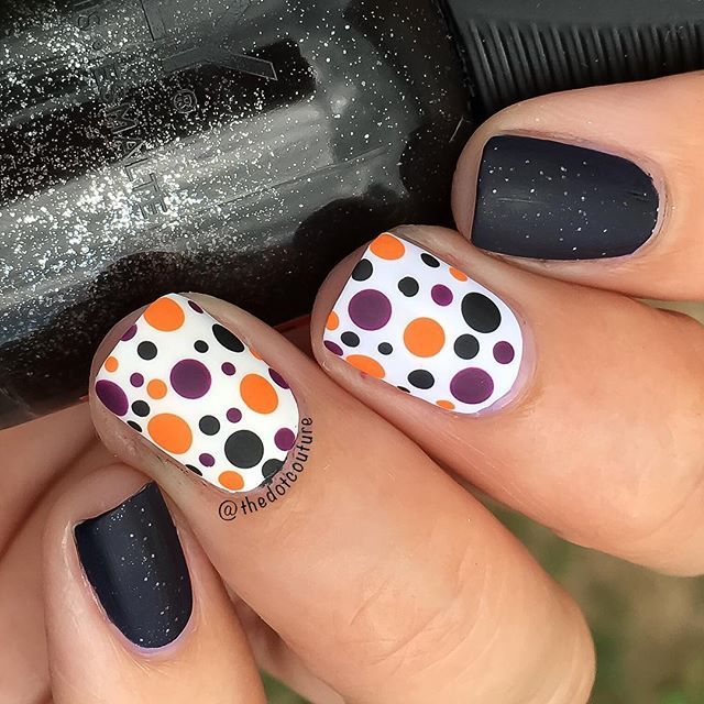 I love how you can get a Halloweeny look without going all out ghosts, bats, and pumpkins. I used a Halloween-themed palette with white, black, orange, and purple to create a Halloween dotticure for @cutegirlshairstyles - no special tools required! Clickable link in my bio for more info!  the base of this mani is @orlynails Goth, which makes an appearance every year at this time! ❤️❤️❤️