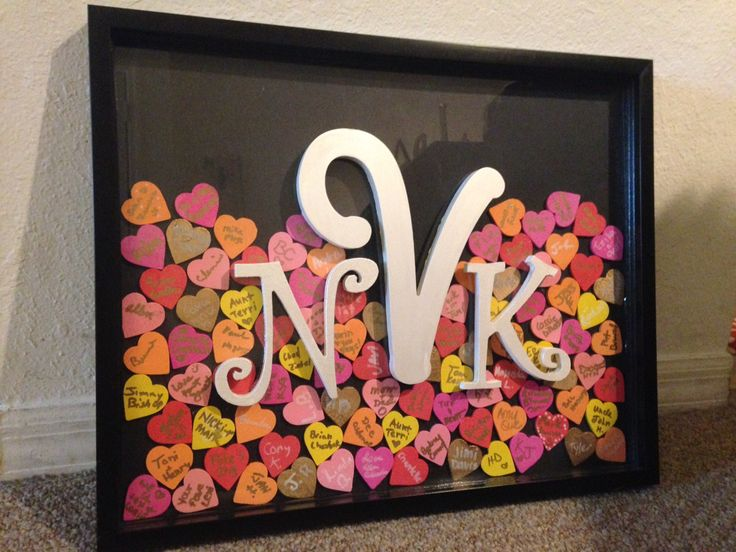 """Alternative Guest Book for Wedding. Shadow box frame with wooden, hand painted hearts drop behind monogram. """"Pick a heart, sign your name, then drop it in our guest book frame"""". Great way to display your guest book from a memorable day <3"""