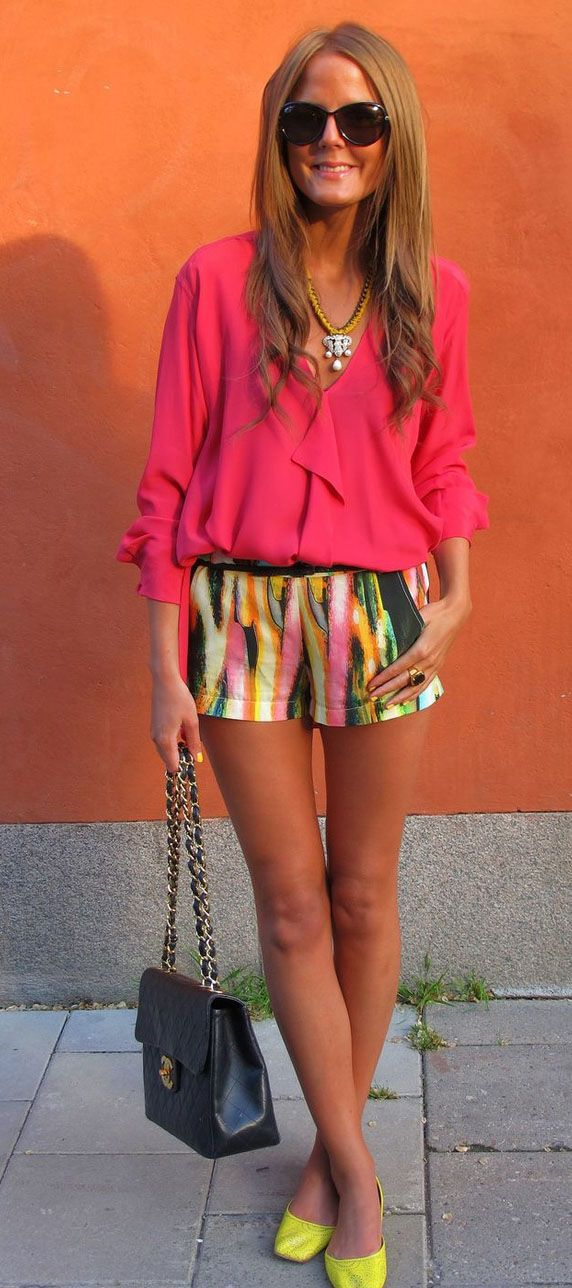 Love the shorts and how it's paired with the bright shirt and shoes.