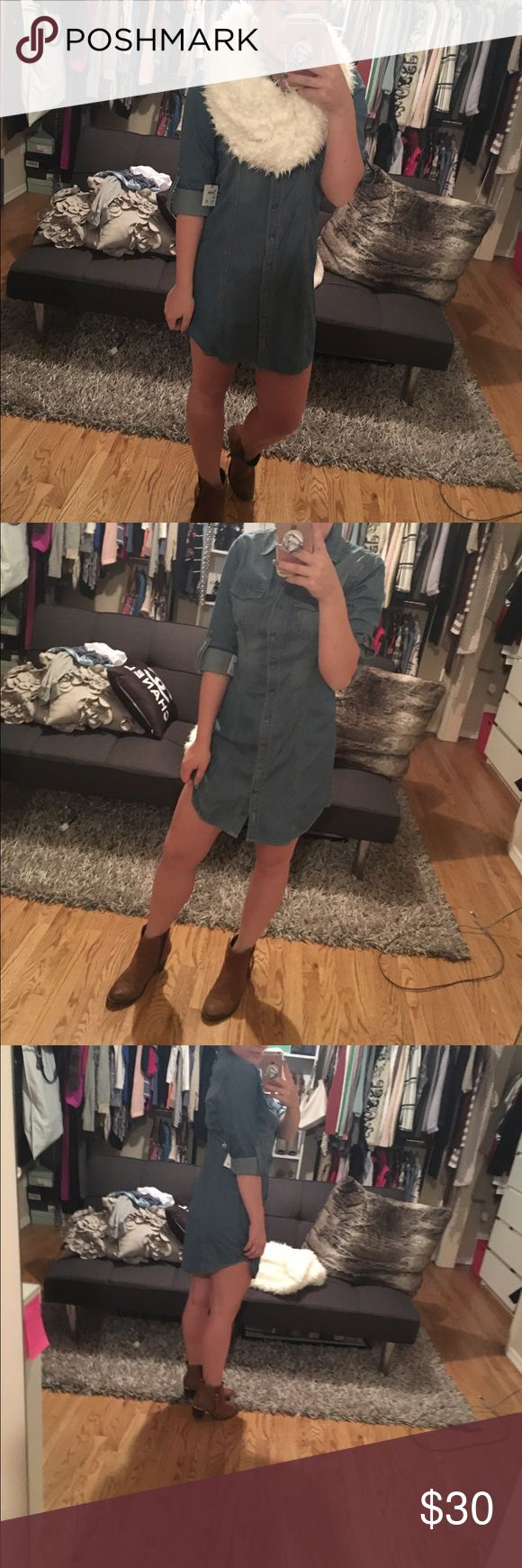 Nordstrom jean dress Have never worn it it still has its tags on the dress! Very stylish paired with a scarf and boots or a stylish belt! Nordstrom Dresses Mini