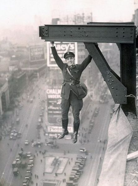 Date unknown A man hangs from a skyscraper in New York City. More power to ya, Bud...