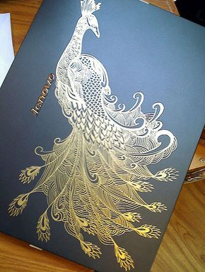A golden pen was used to draw the painting on the cover of a notebook PC - Golden peacock by ~waver-h on deviantART