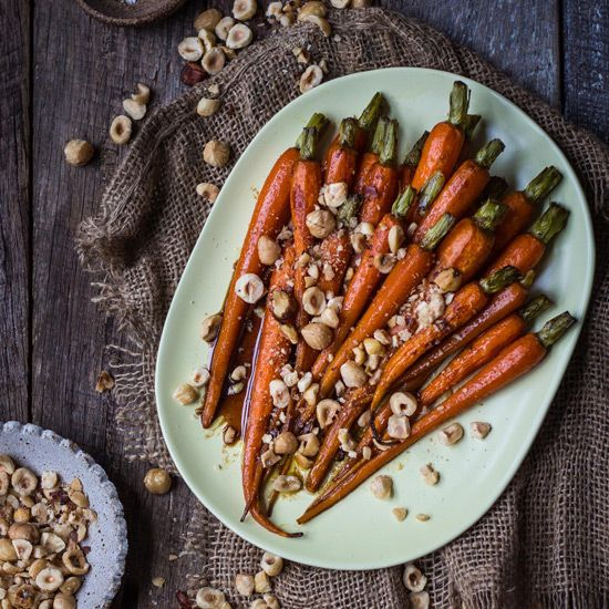 Beautifully glazed and sticky outside and soft and tender inside, these honey balsamic carrots + hazelnuts will be your favourite staple.