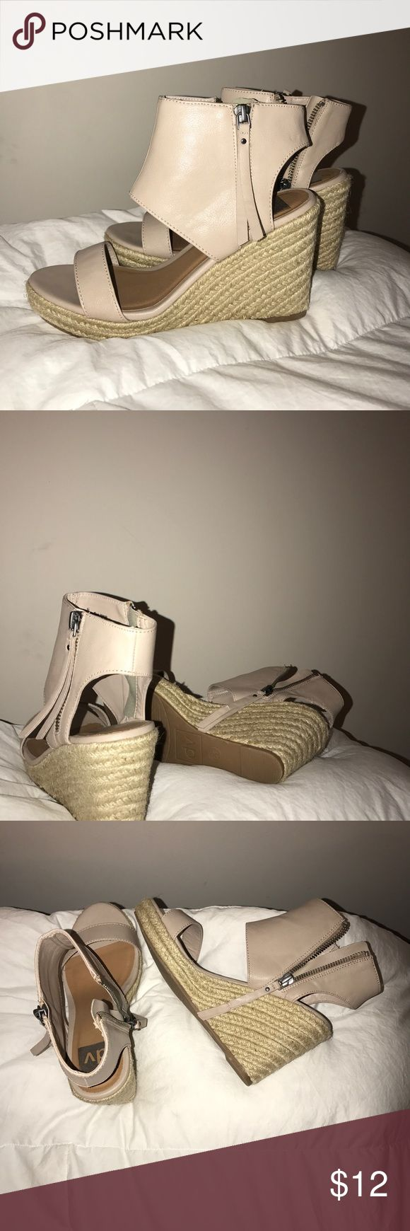 "6.5 Wedge Sandals Summer style wedge sandals  Tan color  Slight wear, no major flaws  Size women's 6.5  Fits true to size  Comfortable  Zips up on inside of foot  Barely worn, like new  Not sure what brand, just say ""dv"" DV by Dolce Vita Shoes Wedges Summer Beach Beachy Tan Beige Zip-up Fashion Chic Cute Heels"