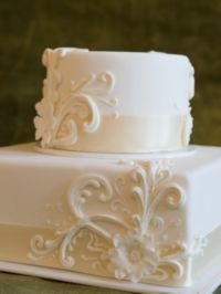 Buttercream Wedding Cakes. Love the simplicity, but the scrollwork could match the dress!
