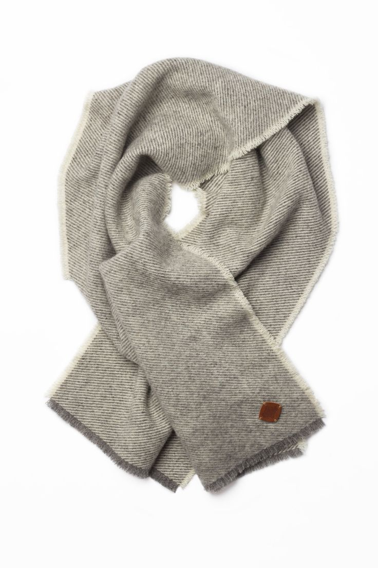 """A substantial, men's wear style woven wool scarf made from Canadian heritage wool. Dimensions 14"""" wide by 48"""" long (35 cm x 123 cm) Available in Slate. Product of Canada."""