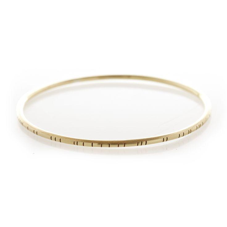 Dear Rae Jewellery   Stripy brass bangle. A thin stripy brass bangle with rounded edges.