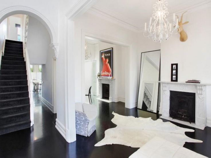 The black floors! The white walls! The modern touches mixed in with the glamor! Le sigh.