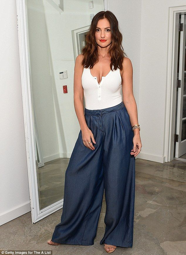 Brunette beauty: She tucked the top into flared navy Armani Exchange trousers and strappy brown Rag & Bone heels