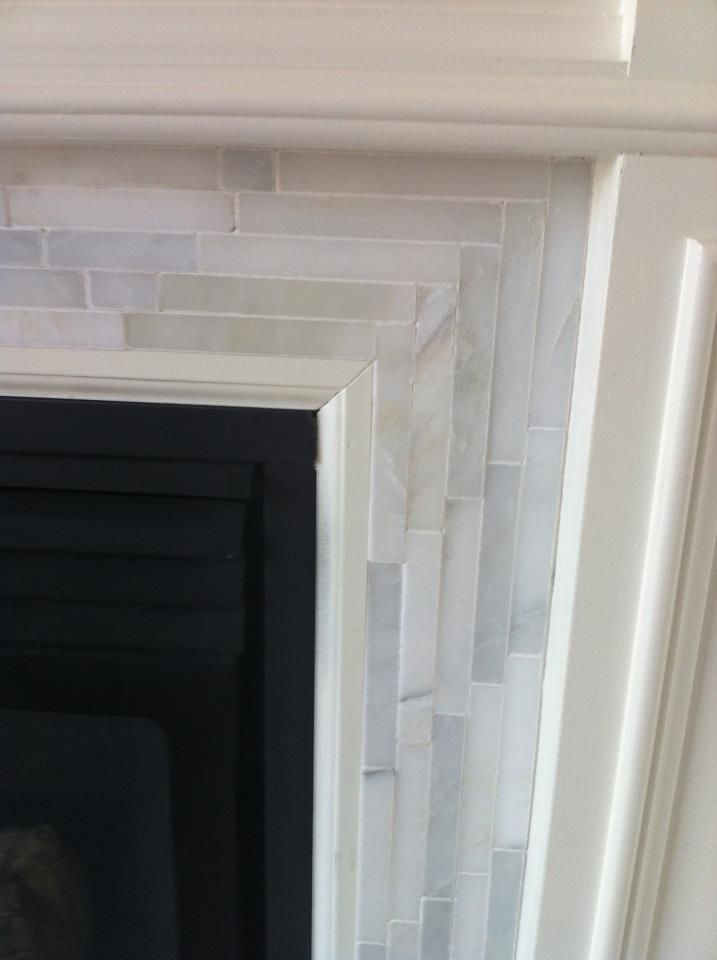 Marble Mosaic Tile on the Fireplace Surround with herringbone pattern for the corners - Chris Kauffman blog