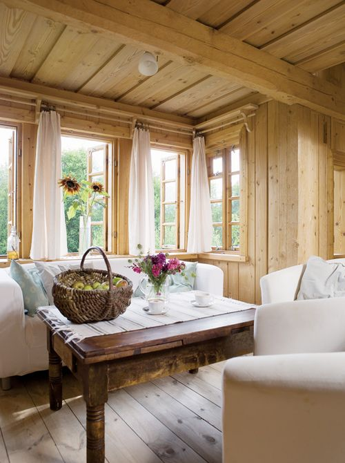 I lve the freshness and simplicity of this wood paneled room...
