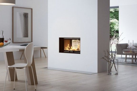 RAIS Visio 2:1 makes for a fantastic connection between two individual rooms - or a partition wall dividing such rooms. #design #fireplace #rais #interiordesign #homedecor#architecture