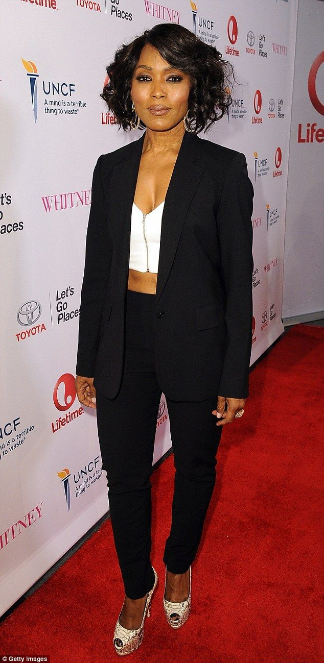 Making a lasting impression: An ageless Angela Bassett looked her absolute best in a white crop top and boyfriend blazer for the premiere of her directorial debut, Whitney, in Beverly Hills on Tuesday