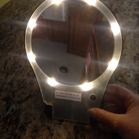 Make up mirror Battery powered make up mirror glass is in okay conditions limited small scratches mirror measures 6inches. magnified Other