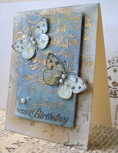 handmade birthday card ...  sponged Distress Inks in blues and browns ... gold embossed leafy flourishes on tomp ... pearls ... two lovely stamped, colored, cut out and popped up butterflies ... shabby chic sty without the ribbon or lace ... gorgeous card!!