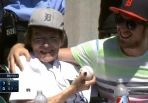 John Oberg (r.) caught a foul ball at a Detroit Tigers baseball game and immediately gave it to his mother Karen Oberg.
