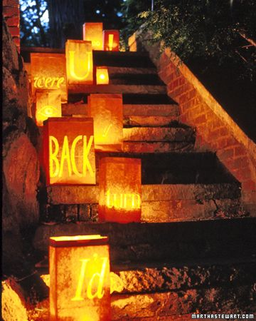 I love using these to line walkways on almost any holiday occasion. Simply cut out whatever you want on the bags and weigh them down with sand or rocks so they don't get blown away and then add a tea light inside each one. =]