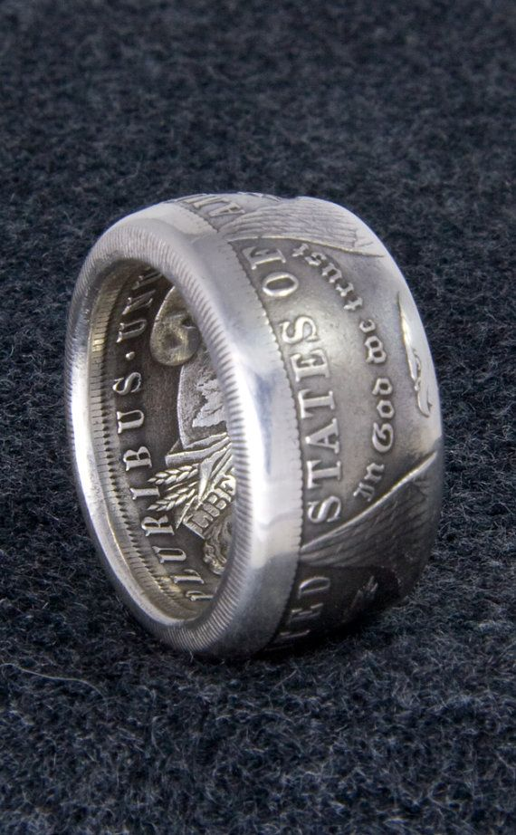 This Double Sided Silver Coin Ring was handmade from a 90% Silver US Morgan Dollar Coin, minted in 1879. It's available in sizes 9-22 including