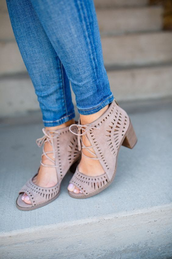 """Make a statement in these Eye-catching geometric cutout sandals. They feature an open-toe lace-up style made of faux suede and set on a chunky 3 inch stacked heel with a 3 1/4"""" shaft. They lace up the"""