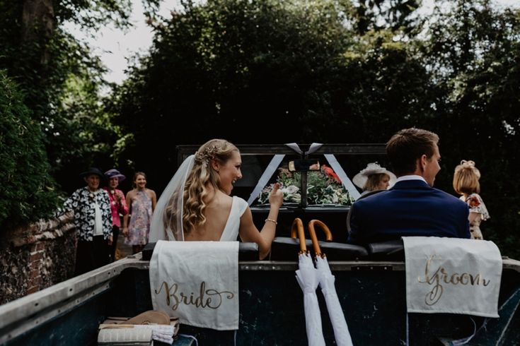 The groom's Jeep kitted out with brollies and named seat covers ready to whisk the bride and groom away. Photo by Benjamin Stuart Photography #weddingphotography #weddingcar #brideandgroom #justmarried