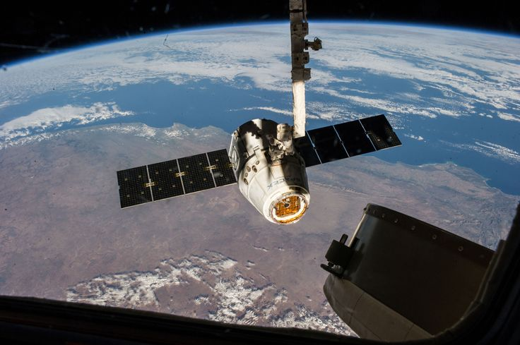 The SpaceX Dragon commercial cargo craft pictured just prior to being released by the International Space Station's Canadarm2 robotic arm on May 18, 2014 [4256 × 2832]