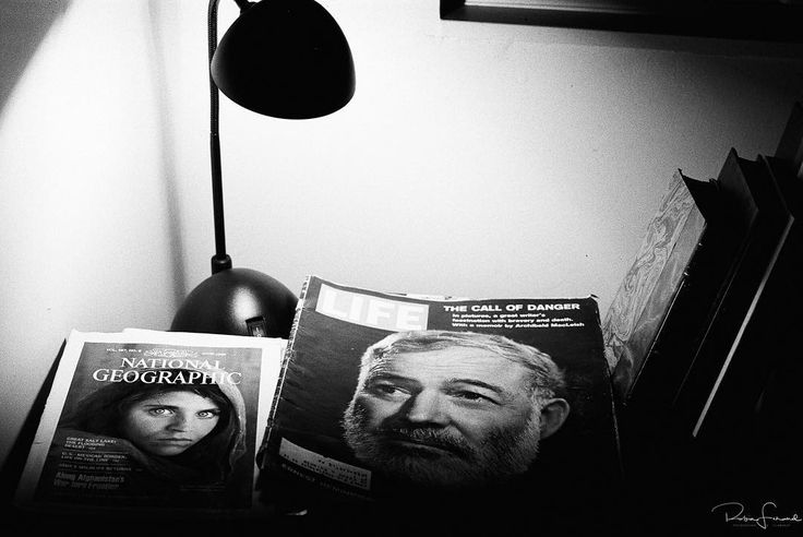 "Reading.  Finishing the two last exposures of an Ilford HP5 film roll.  My nightstand.  I got myself a copy of the National Geographic Issue featuring the famous ""Afghan Girl"" from 1984.  Also got an Issue from1961 of LIFE magazine featuring the death of legendary writer Ernest Hemingway. #nikonF3 #ilfordhp5"
