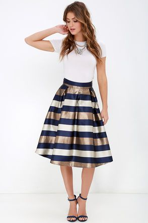 Try not to be too much of a fashion distraction as the ships roll in! The Dock of the Bay Navy Blue and Bronze Striped Midi Skirt is quite the looker with a high, banded waist that transitions into a full silhouette thanks to elegant box pleats. Woven satin fabric is eye-catching with ivory, navy blue, and glittery bronze stripes that descend the midi length. Exposed silver back zipper.