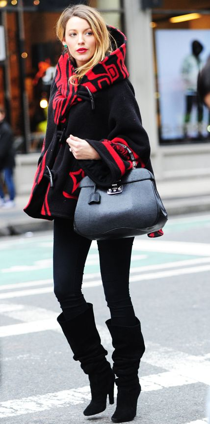 Lively made a statement in a bold ebony-and-scarlet Lindsey Thornburg cloak, black skinny jeans, and chic slouchy boots while out in New York City. The star completed her look with a structured black tote, jade green earrings, and a cherry red lip.
