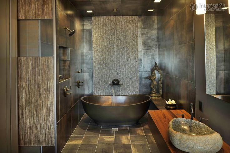 Решение для ванной комнаты в цвете-бронза с отдельно стоящей овальной ванной и каменной накладной раковиной. #дизайн_ванной_комнаты #овальная_ванна #каменная_раковина #современная_ванная_комната #отдельно_стоящая_ванна #аксессуары_для_ванной_комнаты #бронзовая_ванная_комната