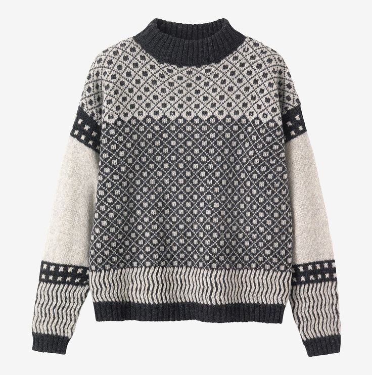 Slouchy Fair Isle pullover in a warm, traditionally spun lambswool. Ribbed neck, dropped shoulers and long, cosy sleeves.