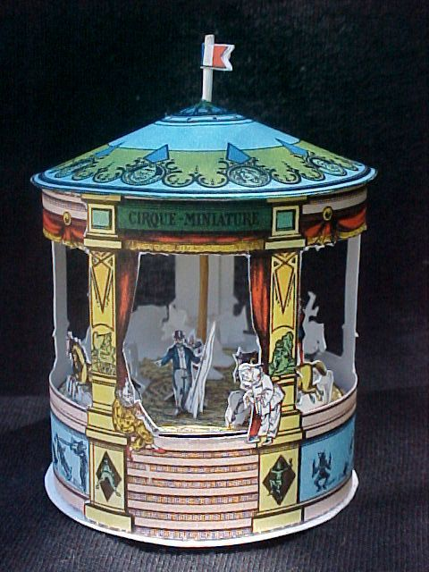 Miniature Assembled recreation of Antique Epinal Circus Carousel. 95.00, via Etsy. http://www.etsy.com/listing/101276089/miniature-assembled-recreation-of#
