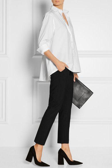 Totême (shirt). Theory (pants). Victoria Beckham (pumps). Proenza Schouler (clutch).