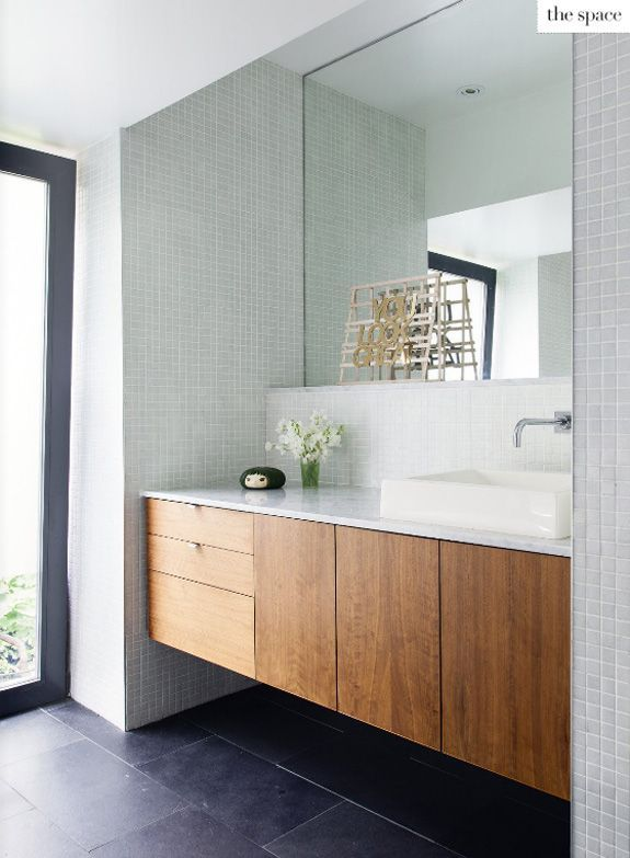 Shaun and Todd's modern bathroom connects the indoors with the outside. From Covet Garden issue 38, October 2013. Photography by Donna Griffith. www.covetgarden.com