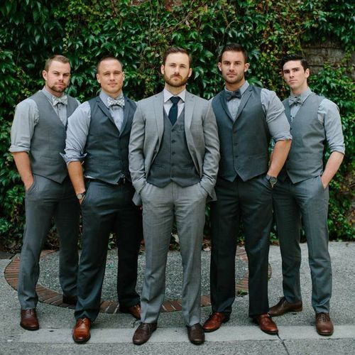 I like how the groomsmen are coordinated with the same look, but wearing different colors Groom Groomsmen Mix and Match Suits Blue Bow Tie Vest Gray_Go Bespoke