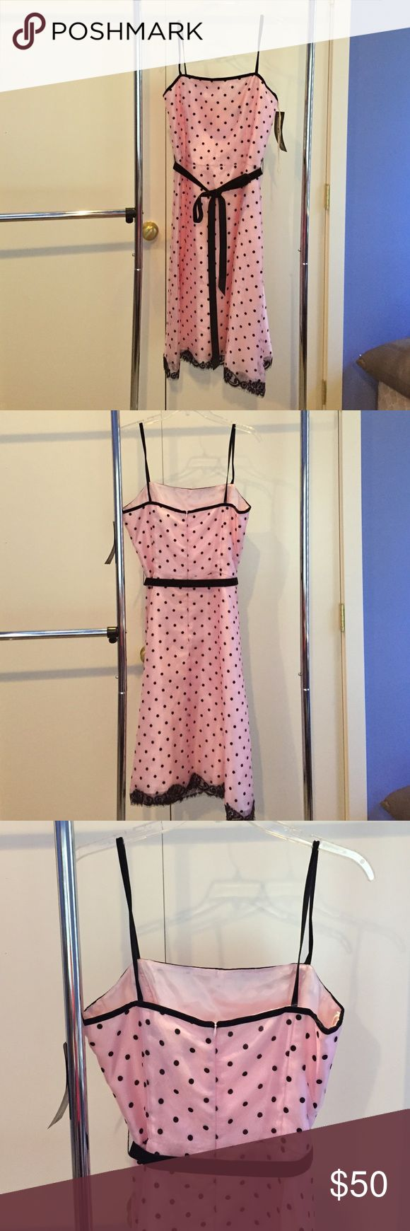 Pink with black polka dot formal dress size 12 Darling pink and black polka dot formal dress. Would be perfect for formal events. High neckline with felt trim, felt black polka dots and removable felt tie sash. Full skirt with tulle on the bottom Jessica Howard Dresses Prom