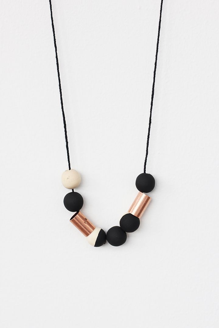 Make this handmade wood bead necklace with copper beads from the hardware store. Perfect for your Fall outfits.