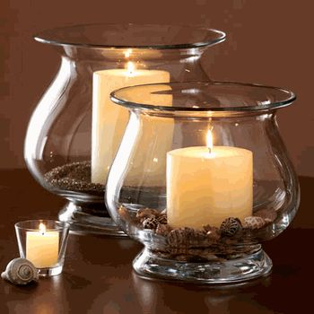 candles in coffee beans & ground coffee inside lovely hurricanes.if you burn tea candles in coffe beans it smells like freshly roasted coffe