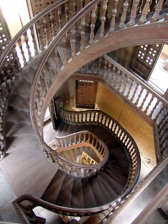 Within this magnificent house, built for the Belgian industrialist Baron Empain, is a set of beautiful wooden spiral stairs that weave through the center of the house.