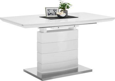 Dieser Esstisch ist ein wahres Multitalent! Schon allein durch seine chice Optik kann er sofort überzeugen: Das leicht gewölbte Säulenbein ist vierfach unterteilt und steht auf einer Platte aus Edelstahl. Die ebenfalls leicht geschwungene, hochglänzend lackierte Tischplatte ist aus hochwertigem Holzwerkstoff hergestellt und zusätzlich mit einer Platte aus Sicherheitsglas versehen. Doch damit nicht genug: Dank Butterfly-Auszug lässt sich der Tisch von ca. 140 cm auf ca. 180 cm verlängern. So…