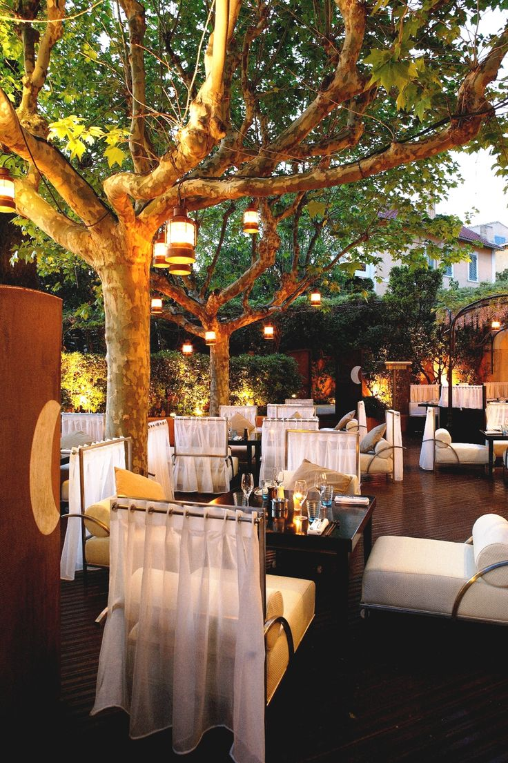 Restaurant Rivea at Hotel Byblos in St. Tropez offers a magical and romantic experience as you dine on classic Mediterranean dishes by celebrity chef Alain Ducasse under a lush canopy of trees and hanging lanterns. I loved this place and the suite I had in the hotel.