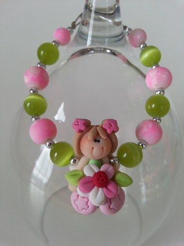 Here is a special gift to offer for children anniversary, Valentine's day... A bracelet made with fimo little girl, cat eye beads and rubber beads.  Sent in an organza pouch.  Lenght:  6 inches  *****