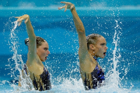 Jenna Randall and Olivia Federici of Great Britain compete during the women's duet synchronized swimming free routine at the Aquatics Centre in the Olympic Park during the 2012 Summer Olympics in London, Monday, Aug. 6, 2012.