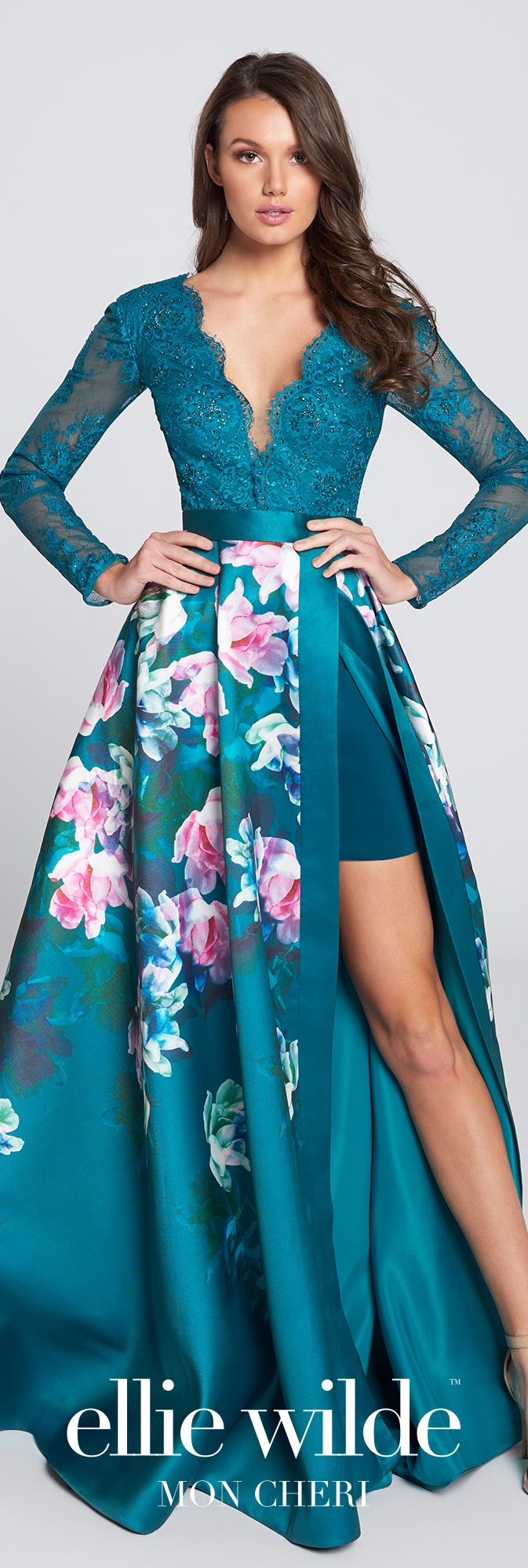 Long sleeve lace bodice floral print prom dress. A-line gown, plunging V-neckline, large keyhole back, Mikado overskirt with side slit, short underskirt.