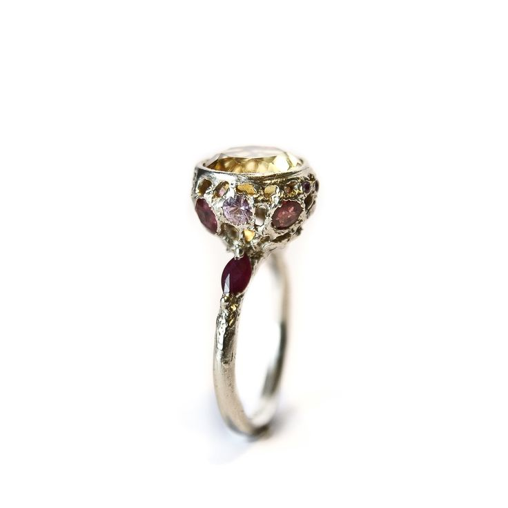 Stoned Collection    Big, sophisticated and luminous 14K white gold ring with multiple gems (rubies and sapphires) in warm colors that enrich the original yellow citrine, depending on light and movement. Ancient character with a modern twist.    The stone is high quality citrine.     Stone size: 10mm