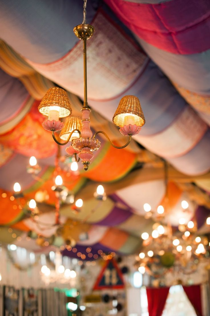 Drapes and fairy lights in the roof.