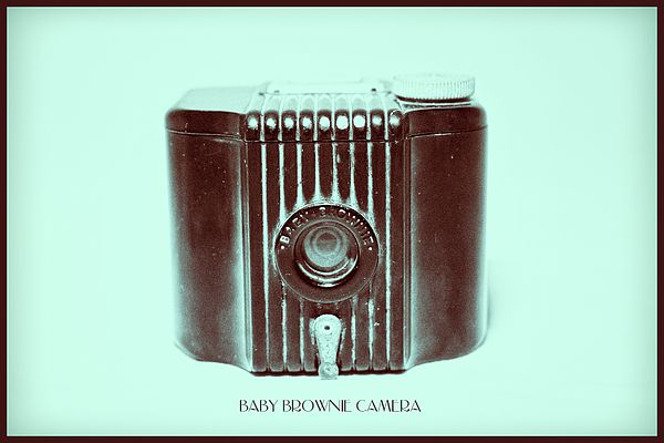 Dark Brown Sepia And Turquoise Art Deco Baby Brownie- Baby Brownie is a small, basic film camera (art deco style), made of Bakelite with a flip-up frame viewfinder. The shutter is operated by the lever under the lens. The camera was manufactured from 1934 to 1941 in the USA and from 1948 to 1952 in the UK.