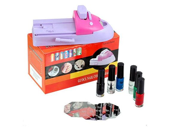 Nail Colors Machine    Product description    Colors Nail Machine, to decorate the nails with beautiful pictures, flowers, animals.  Specifications    Weight: 530g  Dimensions: 19cm x 8cm x 3cm (approx)   Size of the image plate: 5.8cm x 5.8cm (approx.)   Different types and styles      Included in delivery    instructions  6 templates  Nail polish in 7 colors  Nail colora la macchina    Descrizione del prodotto    Colori Nail Machine, per decorare le unghie con foto belle, fiori, animali…